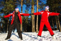 Happy beautiful couple. Jumps in snowly , expressing their happiness Stock Photography