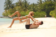 Happy Beautiful Couple having fun Enjoying At Beach in Maldives sunny day hot sand Stock Images