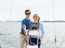 Happy and beautiful couple having a good time on a yacht. Travel Royalty Free Stock Photography