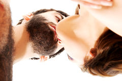 Happy beautiful couple kissing. Happy shirtless beautiful couple kissing Stock Photography