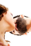 Happy beautiful couple kissing. Happy shirtless beautiful couple kissing Royalty Free Stock Photos