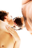Happy beautiful couple kissing. Happy shirtless beautiful couple kissing Stock Images