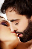 Happy beautiful couple kissing. Stock Images