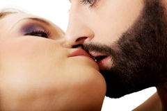 Happy beautiful couple kissing. Happy young beautiful couple kissing Royalty Free Stock Photos
