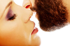 Happy beautiful couple kissing. Happy young beautiful couple kissing Stock Photography
