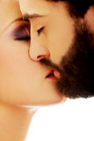 Happy beautiful couple kissing. Happy young beautiful couple kissing Royalty Free Stock Images