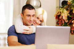 Happy beautiful couple with laptop Stock Photography