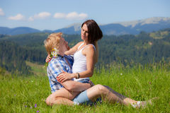 Happy beautiful couple in love. On the green grass field Stock Photo