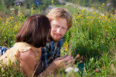 Happy beautiful couple in love. On the green grass field stock images