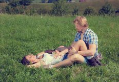 Happy beautiful couple in love. On the green grass field stock photos