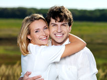 Happy beautiful couple on nature Royalty Free Stock Photos