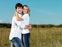Happy beautiful couple on nature Stock Images