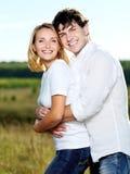 Happy beautiful couple on nature Stock Image