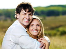 Happy beautiful couple on nature Royalty Free Stock Image