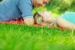 Happy beautiful couple on nature and pregnant in the park royalty free stock image