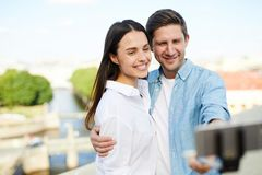 Happy beautiful couple photographing themselves royalty free stock photography