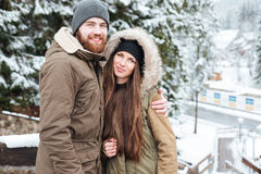 Happy beautiful couple standing together in winter Stock Photos