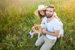 Happy beautiful couple with their Alabai dog in nature with sunset. Stock Photography