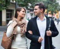 Happy beautiful couple walking in city Stock Image