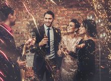Happy beautiful couples celebrating Christmas.  Stock Images