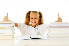 Happy beautiful cute with blond hair little schoolgirl likes studying and reading books in creative education concept with Back to royalty free stock image