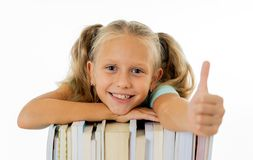 Happy beautiful cute with blond hair little schoolgirl likes studying and reading books in creative education concept with Back to royalty free stock photography