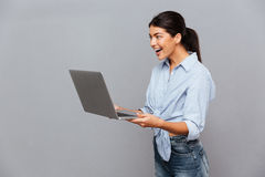 Happy beautiful excited woman using laptop royalty free stock images