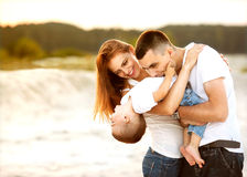 Happy beautiful family on the beach sunset Royalty Free Stock Photos