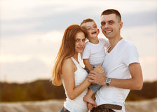 Happy beautiful family on the beach sunset Royalty Free Stock Image