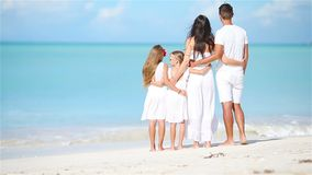 Happy beautiful family on white beach stock footage