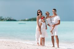 Happy beautiful family with kids on the beach royalty free stock images