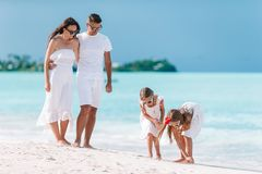 Happy beautiful family with kids on the beach stock photos