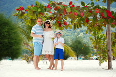 Happy beautiful family on Malibu beach at Koh Phangan Island during summer vacation, Thailand. Asia Stock Images