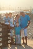 Happy beautiful family standing on bridge Royalty Free Stock Photos