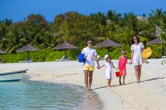 Happy beautiful family on a tropical beach holiday Royalty Free Stock Image