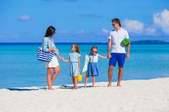 Happy beautiful family on a tropical beach holiday Royalty Free Stock Photo