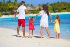 Happy beautiful family on a tropical beach holiday Stock Image