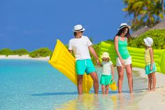 Happy beautiful family on a tropical beach holiday Stock Photography