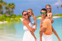 Happy beautiful family on a tropical beach Stock Photos