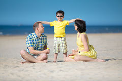 Happy beautiful family on tropical beach vacation Royalty Free Stock Photography