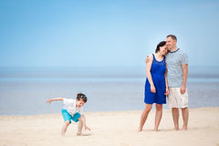 Happy beautiful family on tropical beach vacation Stock Images