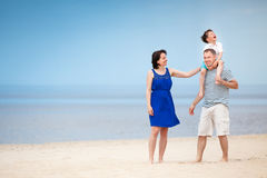 Happy beautiful family on tropical beach vacation Royalty Free Stock Photos