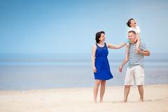 Happy beautiful family on tropical beach vacation Royalty Free Stock Photos