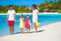 Happy beautiful family vacation on white beach Stock Photo