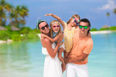 Happy beautiful family vacation on white beach Stock Images