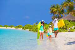 Happy beautiful family on white beach with air Royalty Free Stock Images