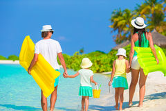 Happy beautiful family on white beach with air Royalty Free Stock Image