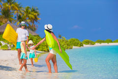 Happy beautiful family on white beach with air Royalty Free Stock Photo