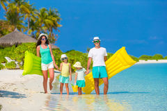 Happy beautiful family on white beach with Royalty Free Stock Image