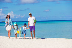 Happy beautiful family on white beach during Royalty Free Stock Photos